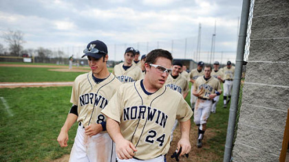 Norwin High School baseball player Rocco Amendola runs back to the dugout with his teammates after congratulating a fellow player on a home run.