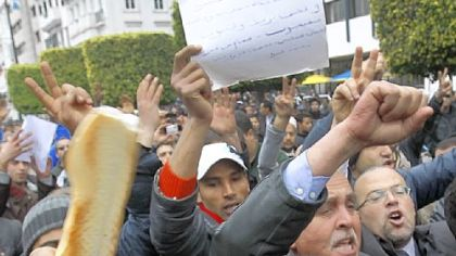 Protesters display bread during a demonstration against the Constitutional Democratic Rally party of deposed President Zine El Abidine Ben Ali in Tunis.