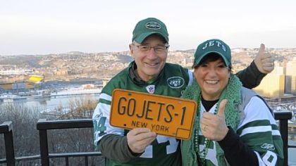 New York Jets fans Marvin and Barbara Schaffer of Long Island show their colors on Mount Washington. Heinz Field is at far left in the background.