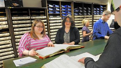 Butler County Recorder of Deeds Michelle Mustello, second from left, helps Meagan Ambrosini, 20, look for grantor records.