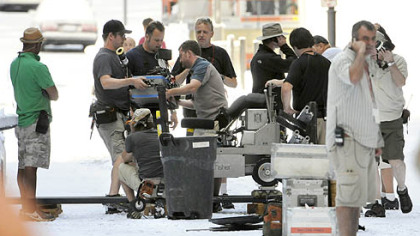 The IMAX camera and dolly track are taken down to prepare for at new shot on snow-covered Oliver Avenue in Downtown Pittsburgh on Aug. 10.