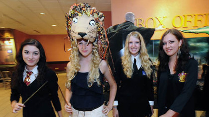 Fans arrive at AMC Loews Theater at the Waterfront for the 12:01 screening of the final Harry Potter film. From left are Nicole Lenderwood, 16, of South Park; Crystal Goettler, 17, of Brentwood; Kristin Cafaro, 17, of South Park; and Suzanne Normile, 17, of South Park.
