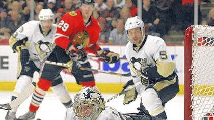 Marc-Andre Fleury deflects the puck away from the goal after a shot by the Chicago Blackhawks in the second period Sunday in Chicago. Fleury had 29 saves but the Blackhawks won in a shootout.