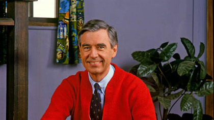 Mister Rogers in the same pose as Daniel Tiger.