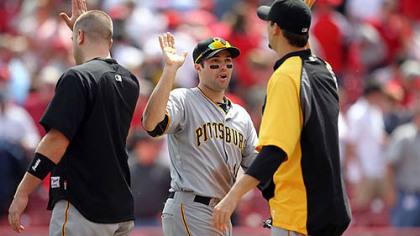 Pirates second baseman Neil Walker, center, is congratulated following Thursday's win against the Reds at Great American Ball Park in Cincinnati.