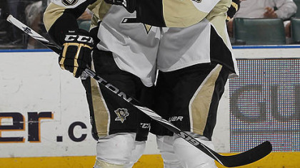 Penguins forwards Pascal Dupuis (left) Maxime Talbot.
