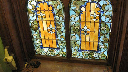 Detail of bottom panels of stained glass in the landing of the Wigman House in Carrick.