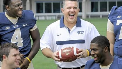 All smiles: Pitt coach Todd Graham shares a laugh with Todd Thomas (4) as the team takes part in media day Monday.