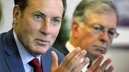 Kenneth Melani, president and CEO of Highmark, left, and David McClenehan, chairman of the board of West Penn Allegheny Health System, speak on Tuesday to the editorial board at the Post-Gazette.