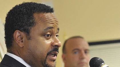 Brian A. Hudson, Sr., executive director and CEO of the Pennsylvania Housing Finance Agency, answers questions Monday at a news conference about aid to homeowners facing foreclosure.  In the background is Allegheny County Executive Dan Onorato.
