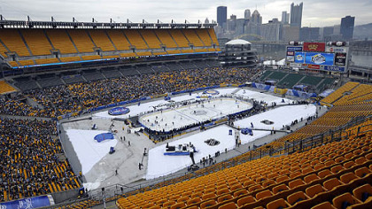 The Penguins practice on the ice Friday at Heinz Field.