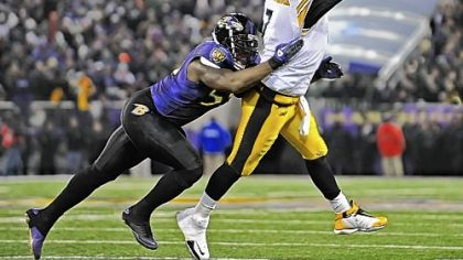 Steelers quarterback Ben Roethlisberger shuffles a pass out of bounds and avoids a sack by the Ravens Terrell Suggs late in the game between the two teams in November in Baltimore. Roethlisberger's play preserved what became the game-winning drive for the Steelers.