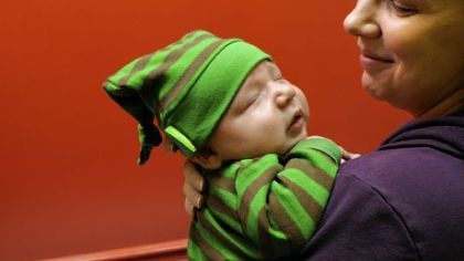 Becky Stratman of Squirrel Hill with 1-month-old son Xavier after he received a hepatitis vaccination.