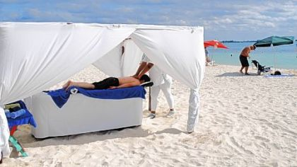 Swimming and snorkeling aren't the only activities for visitors on the sugar-white sands of Isla Mujeres, Mexico. It's also possible to get a massage right on the beach.