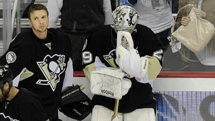 Penguins goaltender Marc-Andre Fleury collects himself next to teammate Brent Johnson after losing to the Lightning Wednesday at Consol Energy Center.