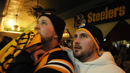 Cousins Tom Falana, left, of Wethersfield, Conn., and Jay Sirois, of Chicago, rooted for the Steelers at Folino&#039;s, on the South Side.