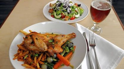 Gerber Farms Roasted Half Chicken served with a pan sauce, Bruges frites and sauteed vegetables, along with a house salad tossed with champagne vinaigrette prepared by Chef Kevin Hunninen at the newly opened Park Bruges in Highland Park.