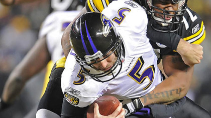 The Steelers' James Harrison sacks Ravens quarterback Joe Flacco.