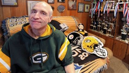 Jim Gregg's home in Pittsburgh's Greenfield neighborhood is a shrine to the basketball and baseball players he has coached at St. Roselia School. He coached Green Bay Packers head coach Mike McCarthy, who played on the school's Pittsburgh Catholic Diocese championship basketball team in 1975, and his decor is now split between the Steelers and Packers.