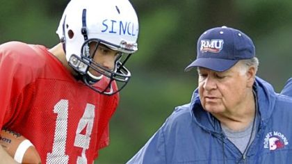Robert Morris University quarterback Jeff Sinclair, a Highlands High School graduate, talks to head coach Joe Walton during a recent practice.