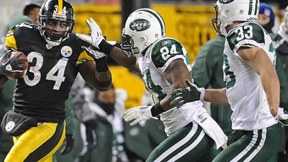 Rashard Mendenhall picks up a first down against the Jets in the first half of the AFC championship Sunday at Heinz Field.