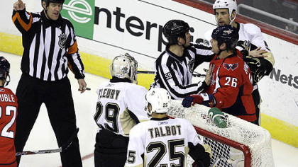 Washington Capitals center Matt Hendricks (26) argues with referees over a call in the second period.