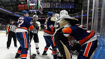 The Islanders and the Penguins fight during the second period of Friday's game at Nassau Coliseum in Uniondale, New York.