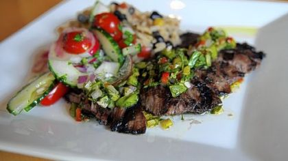 Bife steak chimichurri con gallo pinto (Argentina): Grilled marinated skirt steak topped with chimichurri with black beans and rice created by Chef Martin Lamarche, Alma, a new Pan-Latin American restaurant in Regent Square.