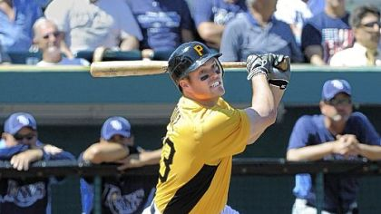 Matt Diaz hits a home run Monday against the Rays at McKechnie Field in Bradenton, Fla.