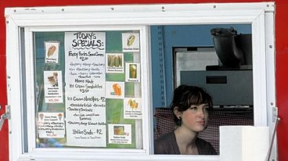 Millie Gregor, from Point Breeze, waits for customers inside the Goodie Truck on a June day.