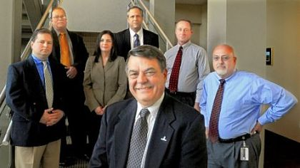GAI Consultants CEO Gary M. DeJidas (foreground) with David Mollish, Ray Sutherland, Jennifer Broucsh, Stephen Gould, Karl Palvisak and Harry Trout. All are graduates of the mobile MBA program at Point Park University.