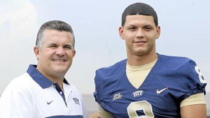 Pitt head coach Todd Graham poses with quarterback Anthony Gonzalez during media day Monday afternoon.