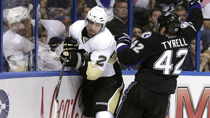 Tampa Bay center Dana Tyrell  slams Matt Niskanen into the boards in the second period of Game 3 of the Penguins-Lightning series Monday in Tampa, Fla.
