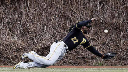 Andrew McCutchen, took a dive on the Wrigley Field grass.