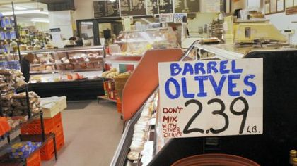 Meats, cheeses, bread and olives are on display at 