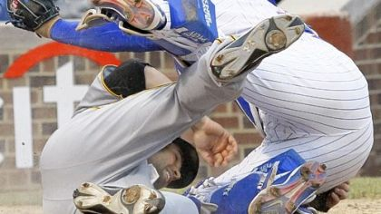 Neil Walker, left, collides with Chicago Cubs catcher Geovany Soto while scoring a run in the ninth inning Sunday at Wrigley Field in Chicago. Walker scored the go-ahead run in the Pirates&#039; 5-4 victory.