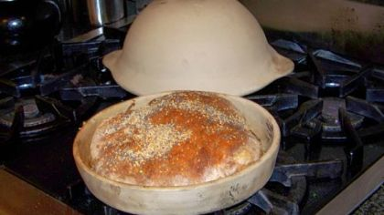 Bread baked in a clay pot with the lid.