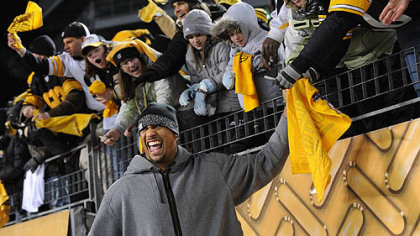 LaMarr Woodley greets fans at a rally at Heinz Field on Friday before leaving for the Super Bowl.