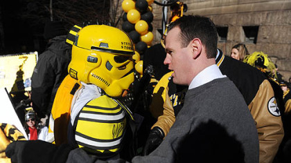 Pittsburgh Mayor Luke Ravenstahl congratulates the Steel City Storm Trooper for winning a costume contest.
