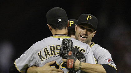 The Pirates' Jeff Karstens is congratulated by teammate Neil Walker after the final out against the Astros at Minute Maid Park in Houston Friday.