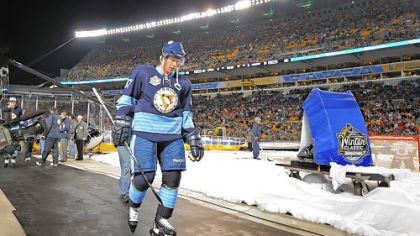 Sidney Crosby heads to locker room after losing to the Capitals in the Winter Classic at Heinz Field last night. Crosby was held scoreless for a second consecutive game.