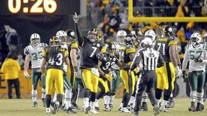 Steelers Ben Roethlisberger celebrates on the last play of the game as his team beats the Jets in the AFC Championship at Heinz Field.