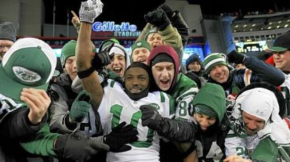 Santonio Holmes of the New York Jets celebrates with fans after the Jets defeated the Patriots 28-21 in their AFC divisional playoff game at Gillette Stadium Sunday.