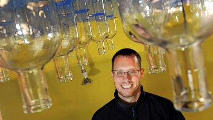 Owner Eric Meyer poses for a portrait in the under-construction Wigle Whiskey, a distillery in the 2400 block of Smallman Street in the Strip District.