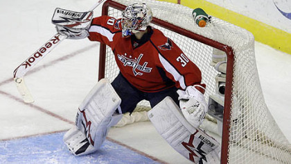 Washington Capitals goalie Michal Neuvirth deflects a shot from the Penguins in the first period.