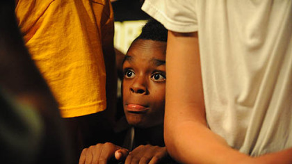 Amir Young, 10, waits for the start of the concert.