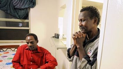 Ismail Omar, left, and fellow Darfurian Mohamed Idris, who live together in Castle Shannon, reflect on their lives and the referendum on southern Sudan's independence. Results of the vote will be announced Wednesday.