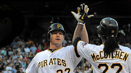 The Pirates' Lyle Overbay is greeted at home by Andrew McCutchen after hitting a three-run home run against the Red Sox at PNC Park Saturday.