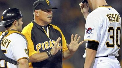 "Ray Searage talks with Chris Resop, right, in a game Aug. 3 at PNC Park. Pirates players say Searage's message to each pitcher is different when he makes a mound visit. Starter James McDonald: ""He knows what buttons to push for each guy."""