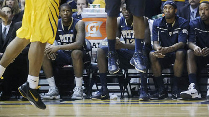 Travon Woodall and Pitt defeated Casey Mitchell and West Virginia, 71-66, at Morgantown, W.Va. Feb. 7.